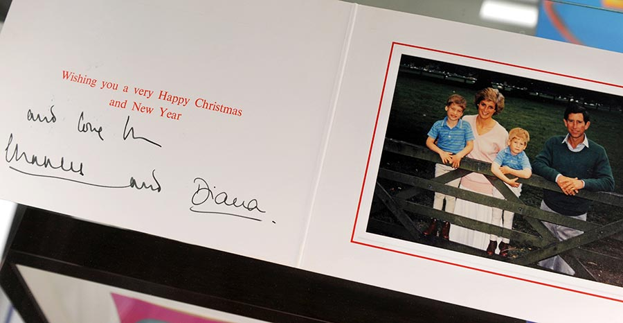 "Prince Charles and Princess Diana Christmas card is seen during the preview day of the ""Icons and Idols"" and ""property from the life and career of Johnny Cash"" auctions at Julien's Auctions in Beverly Hills, California on November 19. 2010. The auctions will be held in Beverly Hills next December 3 and 4. AFP PHOTO / GABRIEL BOUYS (Photo credit should read GABRIEL BOUYS/AFP/Getty Images) Photo: © Getty Images"