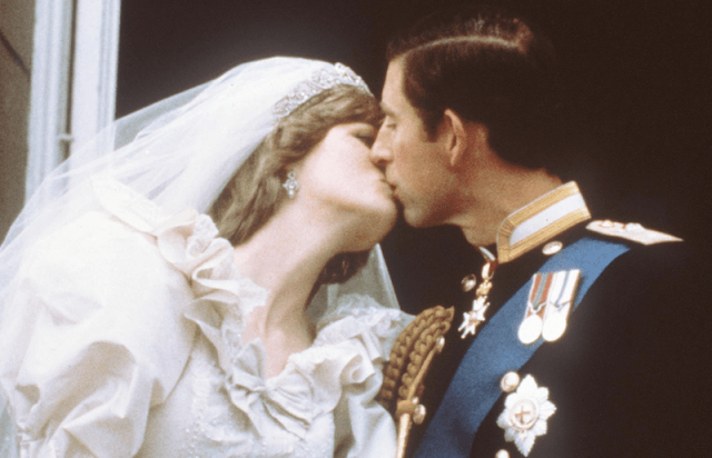 Princess Diana and Prince Charles kiss at their wedding. Photo (C) GETTY IMAGES