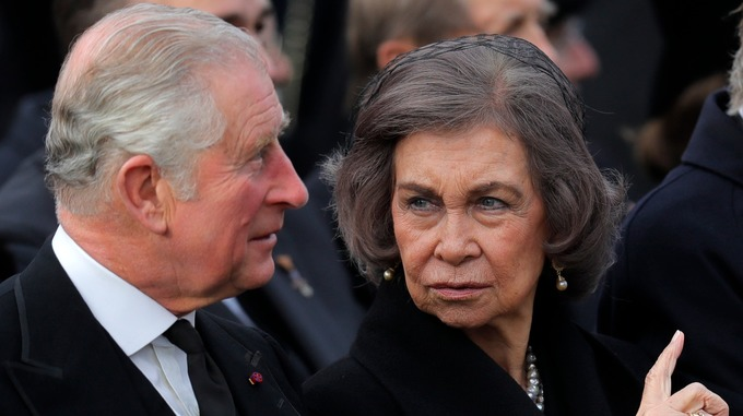 Prince Charles of Britain, left, speaks with former Spanish Queen Sofia during the funeral ceremony. Credit AP