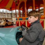 Prince George was spotted behind the wheel as he enjoyed a day out at the fairground