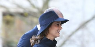 Prince William placed a reassuring hand on his pregnant wife's back as they made their way into the service