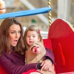 The Duchess of Cambridge appeared to be enjoying a ride on the carousel with her two year old daughter