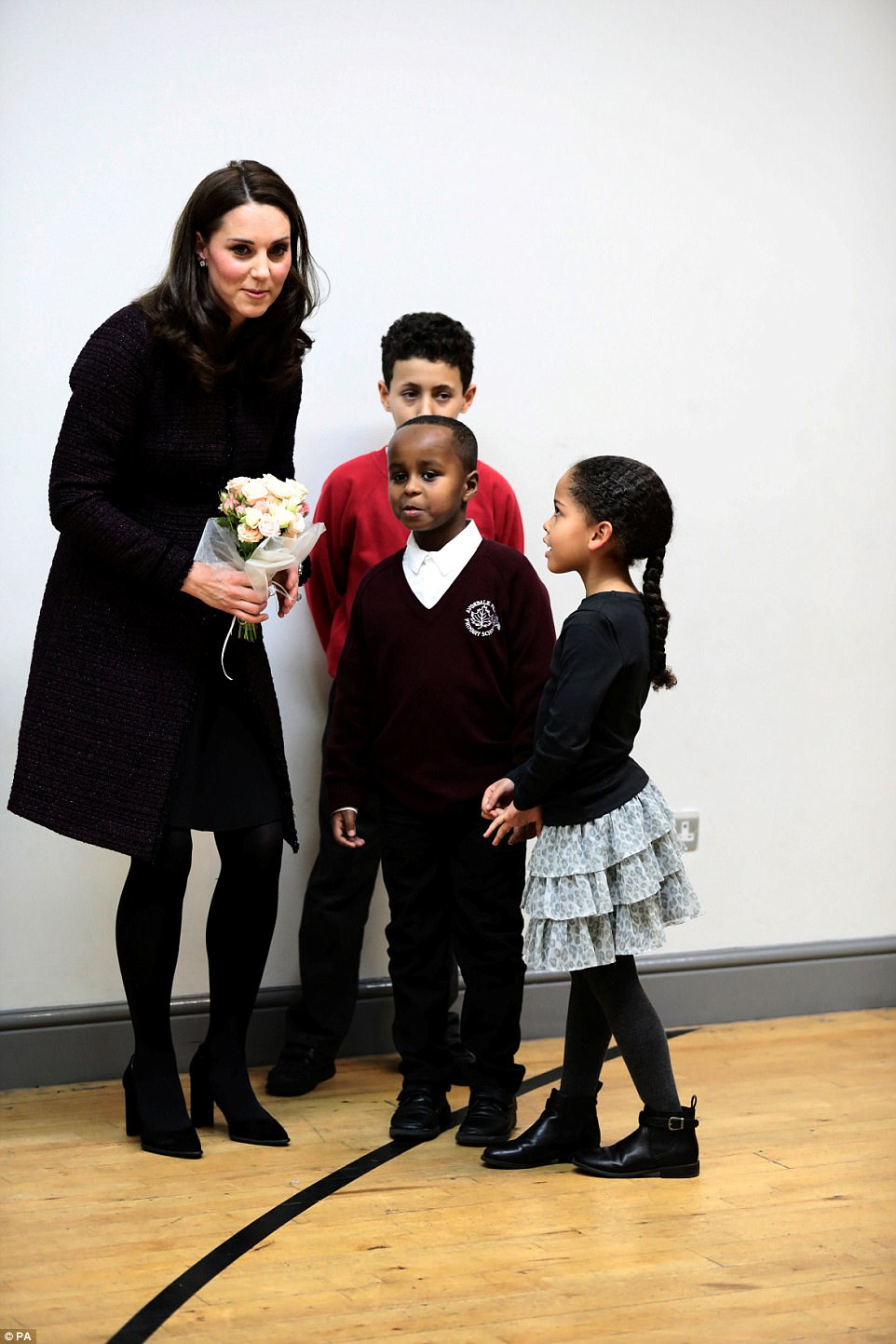 The Duchess of Cambridge speaks to Yahya Hussein Ali, seven, and Dawud Wahabi 10, children affected by the Grenfell Tower fire