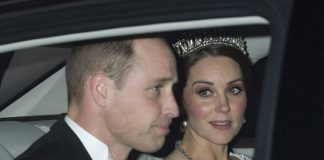 The Duchess swept her famous brunette locks into a low chignon for the glittering event at Buckingham Palace on Tuesday