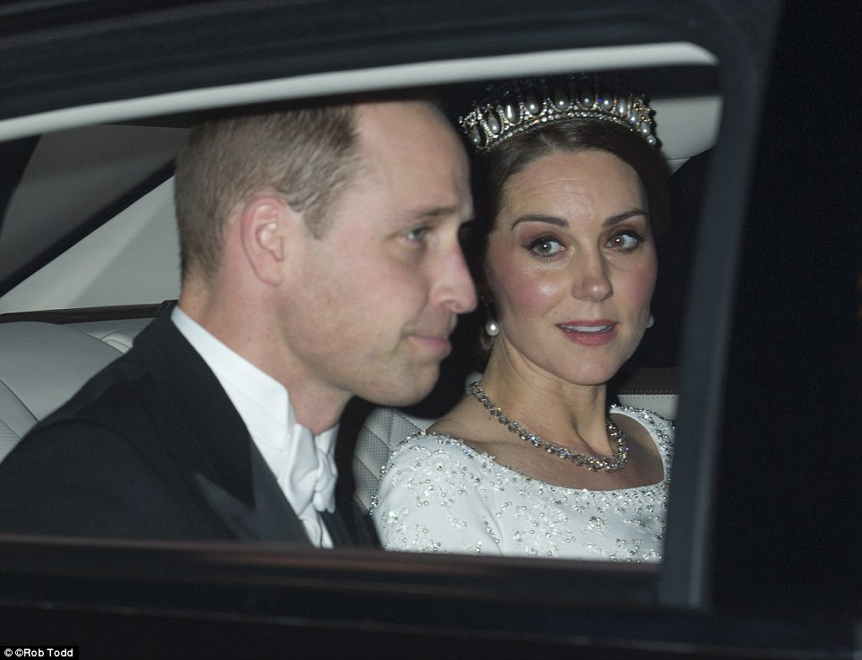 The Duchess swept her famous brunette locks into a low chignon for the glittering event at Buckingham Palace on The Duchess swept her famous brunette locks into a low chignon for the glittering event at Buckingham Palace on TuesdayTuesday