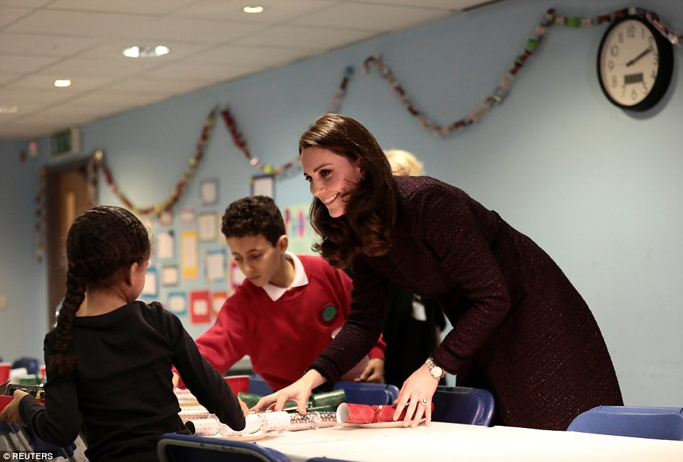 Kate is introduced to staff at the beginning of her visit to the Rugby Portobello Trust in London, which supports people in the local community particularly mothers aKate is introduced to staff at the beginning of her visit to the Rugby Portobello Trust in London, which supports people in the local community particularly mothers and childrennd children
