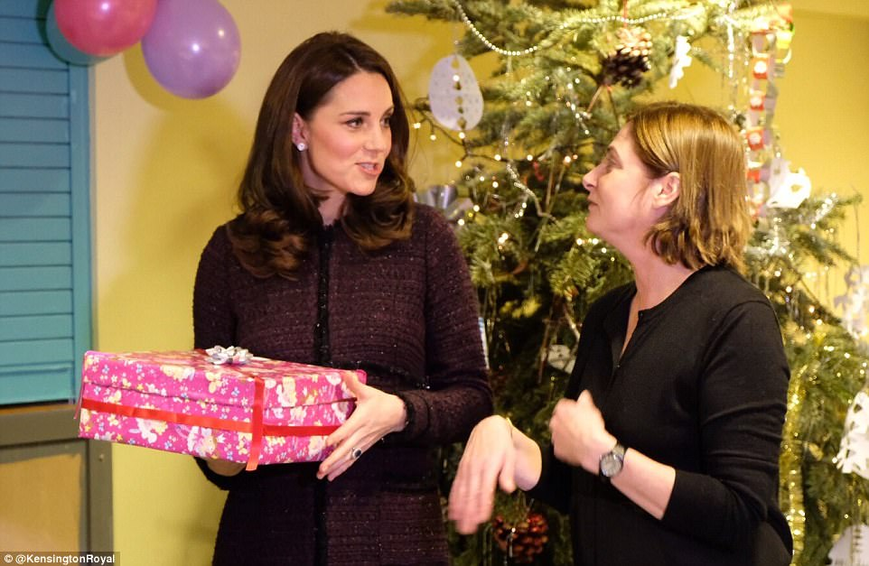 Kate is introduced to staff at the beginning of her visit to the Rugby Portobello Trust in London, which supports people in the local community particularly mothers and children