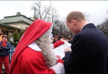 The Duke then handed over a letter written from Prince George to Father Christmas. Photo (C) KENSINGTON PALACE TWITTER