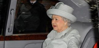 The Queen kept warm in the car Photo (C) GETTY IMAGES