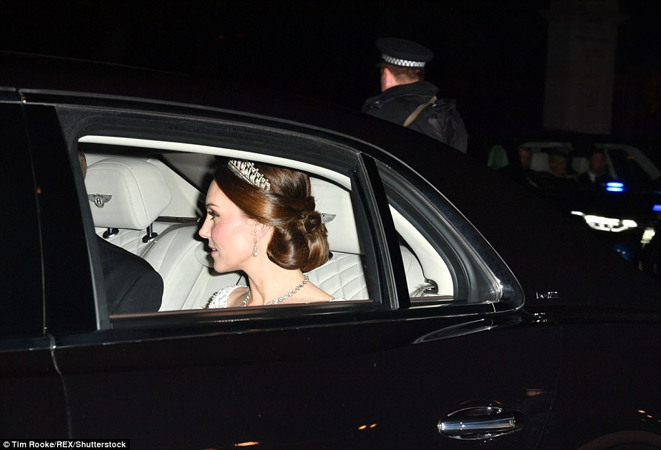The pregnant mother-of-two appeared to be wearing a white silk gown which featured inticate embellishment around the neckline off-set by an elegant diamond necklace