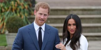 Prince Harry and fiancée Meghan Markle as she shows off her engagement ring