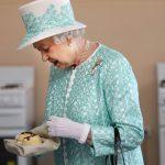 Britains Queen Elizabeth II looks at ho