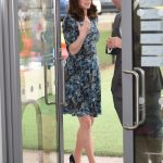 Catherine Duchess of Cambridge showing baby belly photo C PA
