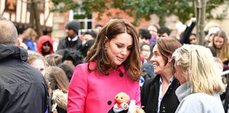 Duchess Kate stunned in the pink statement coat by Mulberry Photo (C) GETTY