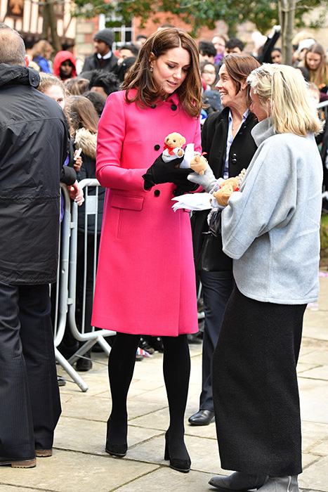 Duchess Kate stunned in the pink statement coat by Mulberry Photo C GETTY