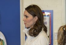 Duchess Kate's baby bump was clearly visible during her visit to Bond Primary School Photo (C) REX