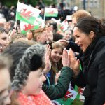 During the walkabout outside Cardiff castle on Thursday Meghan enthusiastically high fived members of the public Photo C GETTY IMAGES