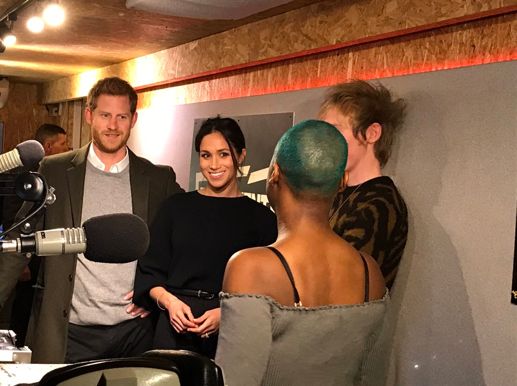 In the On Air studio, Prince Harry and Ms. Markle meet presenter Glory as she records her show for @ReprezentRadio. Photo (C) TWITTER KENSINGTON PALACE