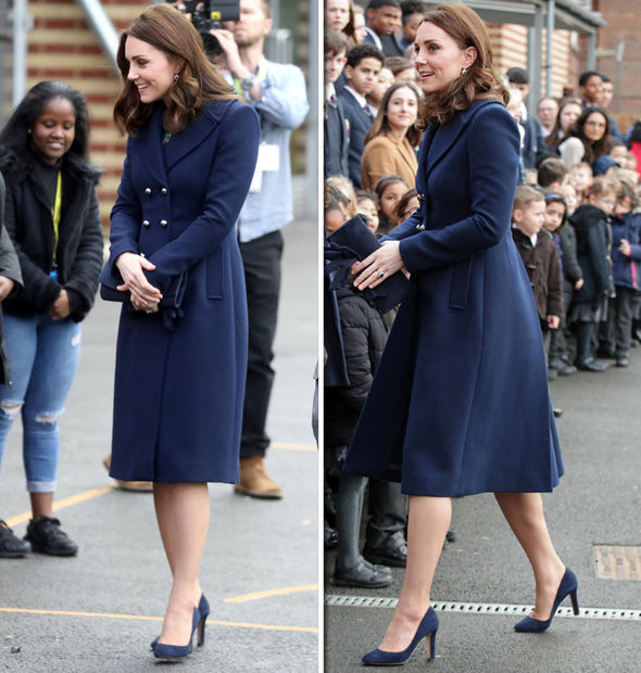 Kate Middleton Pregnant 35 year old wore a navy blue coat and matching accessories Photo C GETTY