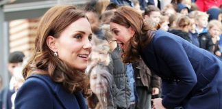 Kate Middleton Pregnant Duchess conceals baby bump in a blue coat without Prince William Photo (C) GETTY