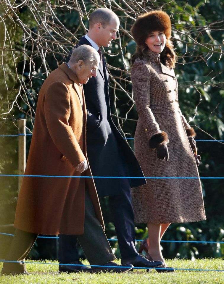 Kate Middleton arrived at Sandringham Church with Prince William and Prince Philip. Photo (C) Getty Images