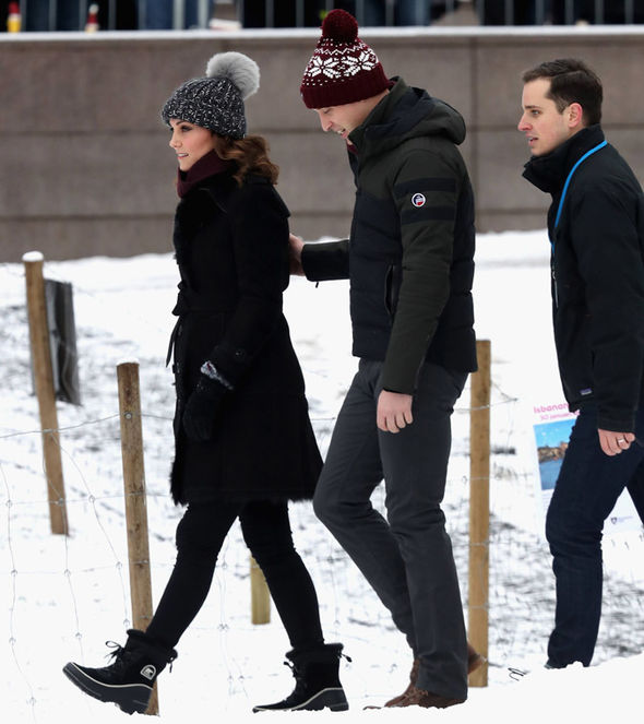 Kate Middleton news The Duchess protected her baby bump from the bitter cold in Stockholm today Photo (C) PA