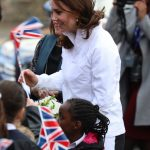 Kate also took part in a tennis match at Bond Primary School Wenn