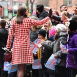 Kate dishes out high fives to excited children Photo C PA