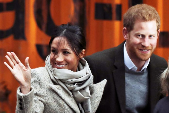 Britain's Prince Harry and his fiancée US actress Meghan Markle arrive for their visit to Reprezent 107.3FM community radio station in Brixton, south west London on January 9, 2018. / AFP PHOTO / Adrian DENNIS (Photo credit should read ADRIAN DENNIS/AFP/Getty Images)