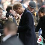 Meghan Markle was given a Welsh flag as she greeted crowd members in Cardiff on Thursday Photo C GETTY IMAGES