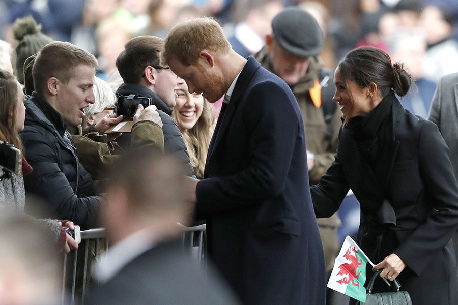 Meghan Markle was given a Welsh flag as she greeted crowd members in Cardiff on Thursday Photo (C) GETTY IMAGES