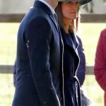Pippa looked stunning in a dark navy coat and hat. Photo C Getty Images