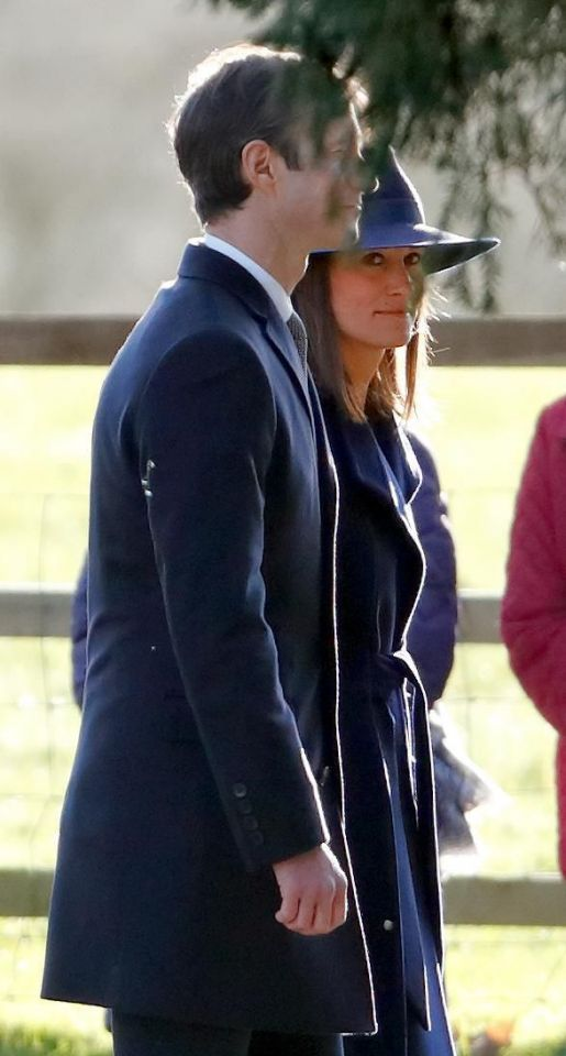 Pippa looked stunning in a dark navy coat and hat. Photo (C) Getty Images