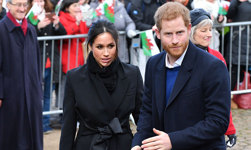 Prince Harry and Meghan Markle dazzle crowds in Cardiff following train delay Photo (C) GETTY