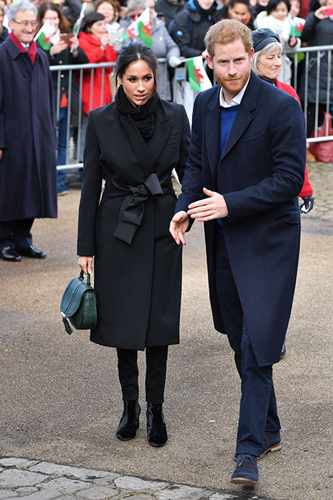 Prince Harry and Meghan Markle stepped out in Cardiff on Thursday for their third royal engagement. Photo (C) GETTY IMAGES