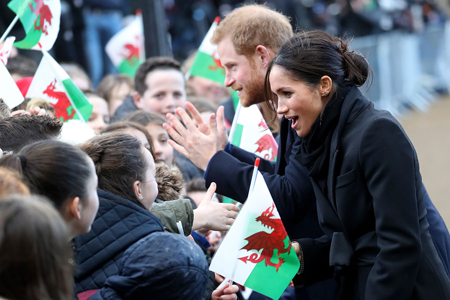 Prince Harry and Meghan Markle's trip to Cardiff were greeted with cheers and applause from well-wishers on Thursday afternoon Photo (C) GETTY IMAGES