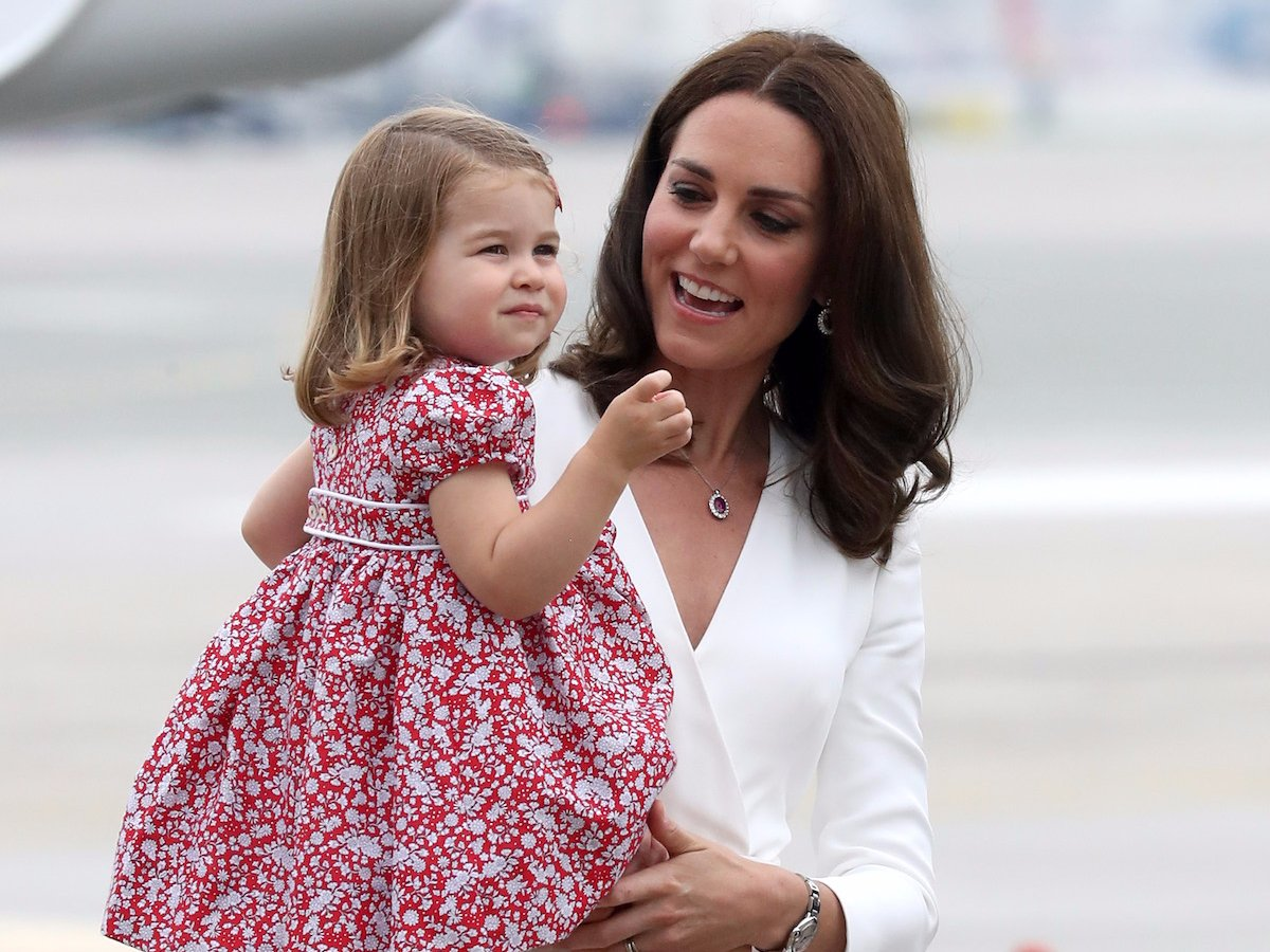 The Queen Mother and Princess Charlotte. Sion Touhig Pool Getty Images