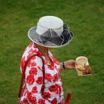 Queen Elizabeth holding tea