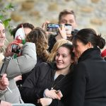 Signing an autograph wasnt the only royal protocol Meghan broke during the walkabout in Cardiff on Thursday. Photo C GETTY IMAGES