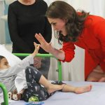 The Duchess of Cambridge with four year old Rafael Chana as she officially opens the Mittal Children Photo C GETTY