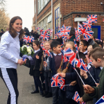 The Duchess receives a warm welcome from Bond Primary School which is one of the 65 local schools that benefit from @WimbledonFdn free tennis coaching