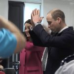 The Duke and Duchess of Cambridge wiggle with staff as they tour the Science and Health Building at Coventry University Photo C GETTY