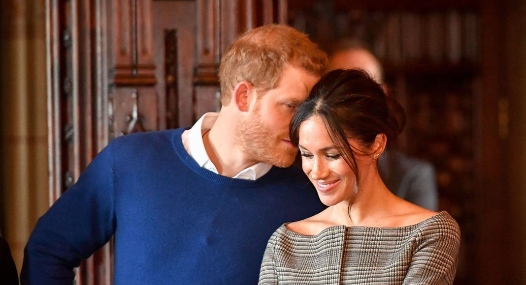Meghan Markle wrapped up in a chic Stella McCartney coat for her royal appearance with Prince Harry Photo (C) GETTY