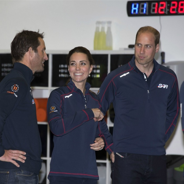 PORTSMOUTH, ENGLAND - JULY 26: Prince William, Duke of Cambridge (R) and Catherine, Duchess of Cambridge (C) share a joke with Sir Ben Ainslie during a visit to the headquarters of Britain's Land Rover-backed BAR team during the America's Cup World Series event on July 26, 2015 in Portsmouth, England. (Photo by Ian Vogler - WPA Pool/Getty Images)