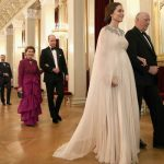 Duchess of Cambridge is escorted into dinner by King Harald V of Norway Photo (C) PA