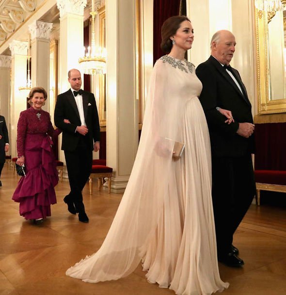 Kate Middleton The dress, which covered the pregnant Duchess's wedding dress, had a sheer cape Photo (C) GETTY