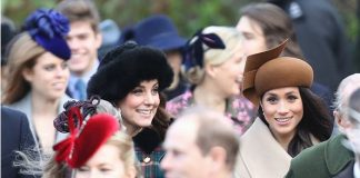 Kate Middleton proudly showed off a small baby bump. Her new baby is due to be born in April next year Photo (C) GETTY