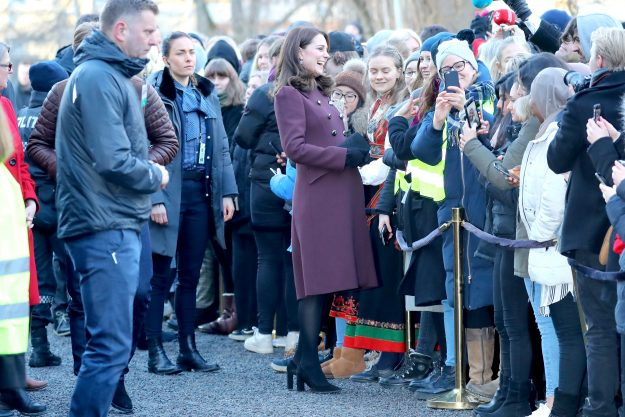 Kate Middleton disguised her baby bump in a burgundy coat [Wenn]