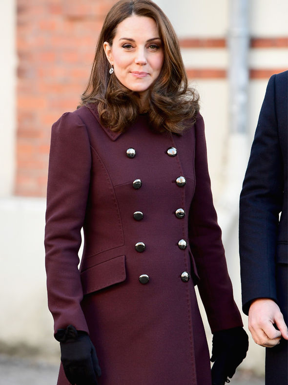 Kate Middleton fashioned an array of warm coats during the visit Photo (C) GETTY