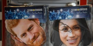 Masks depicting Meghan Markle and Prince Harry on sale Photo (C) EPA